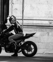 The black Biker and White wall